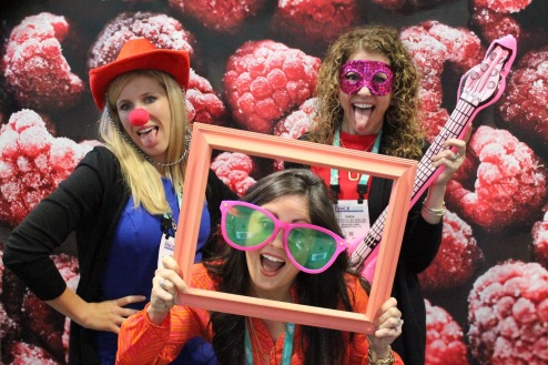Angie Wallick, Blair Mize, and Sara Foley at Raspberry booth at FNCE